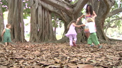 Mother Playing With Children In Garden Stock Footage