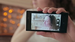 Girl takes a photo of herself Stock Footage