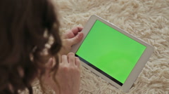 Woman at home using electronic tablet Stock Footage