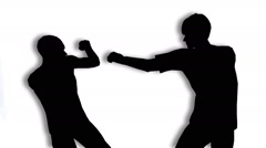 Two men fighting silhouette Stock Footage