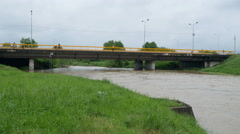 Turbulent river rushing under the bridge after big rainfalls by Pakito. Stock Footage