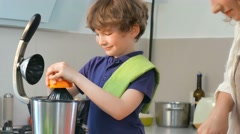 Young Caucasian Mother and Child Homemade Fresh Orange Juice in Kitchen Stock Footage