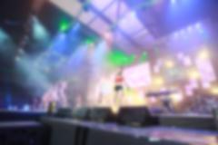 Crowd in front of concert stage with dancer blurred Kuvituskuvat