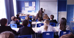 4k, Attractive teacher teaching a classroom in front of a whiteboard. Slow motio - stock footage