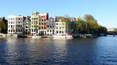 Time Lapse of Tour Boats in the Canals - Amsterdam Netherlands - stock footage