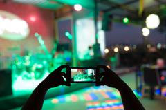 Take photo concert in front of stage - stock photo