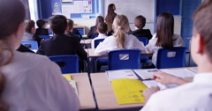 4k, A group of school children raising their hands in class. Slow motion. Stock Footage