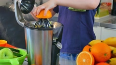 Young Caucasian Child Homemade Fresh Orange Juice in Kitchen  Stock Footage