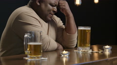 Sad and troubled guy at a bar - stock footage