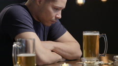 Troubled guy sitting alone at a bar - stock footage