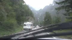 4K Driving Car on Rainy Stormy Day, Traffic on Road, Highway, Windshield View Stock Footage