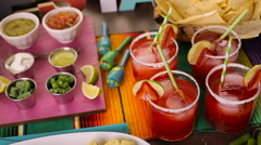 Party table with tamales, strawberry margaritas and pan dulche bread. Stock Footage