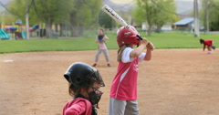 Softball rural community young girl team hit run slow DCI 4K Stock Footage