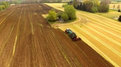 Tractor with Liquid Manure Spreader on field - Aerial view Stock Footage