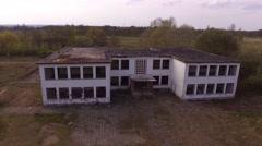Flight over ruin of a school - birdview Stock Footage