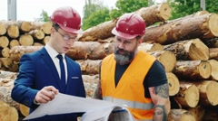 Engineer in a suit and a helmet with a work study construction documents Stock Footage