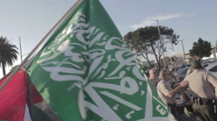 A Hamas flag is flown next to a Palestine flag at a Palestine Protest Stock Footage