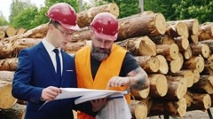 Bearded builder and engineer work together with construction documents and Stock Footage