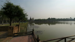 Pan zoom over pond in sukhothai park in thailand Stock Footage