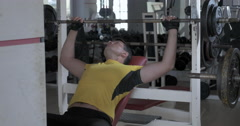 Bench press exercising in the gym Stock Footage