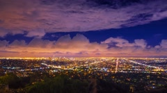 Dramatic storm clouds passing night  city Los Angeles skyline Zoom in Timelapse Stock Footage
