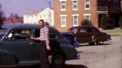 1955: Man making funny face about to enter classic car parked. Stock Footage