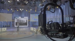 TV Studio with a presenter and the audience during the recording of the show Arkistovideo