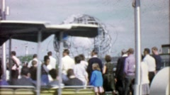 1964: Crowds travel by foot, bus and tramway to EXPO New York World's Fair. - stock footage