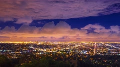 Storm clouds passing city of Los Angeles skyline night Zoom out 4K UHD Timelapse Stock Footage