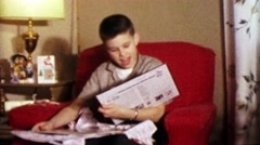 1964: Boy unwraps Smothers Brothers and Burl Ives albums. Stock Footage