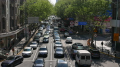 cars driving slowly on city street - stock footage
