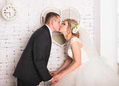 Young wedding couple enjoying romantic moments - stock photo
