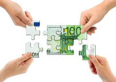 Hands and money puzzle - stock photo
