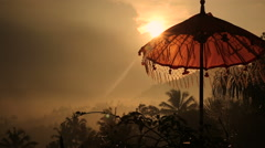 Traditions umbrella on the island of Bali, Sunset Indonesia Stock Footage