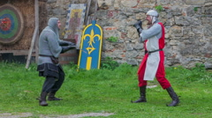 Two knights are fencing against each other Stock Footage