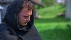 A young knight is bending a bow - stock footage