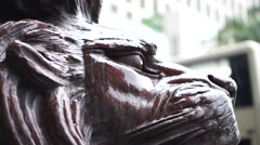 Wet Lion statue at the entrance of HSBC Bank Hong Kong - stock footage