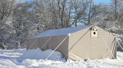 A big tent in the forest in snowy weather Stock Footage