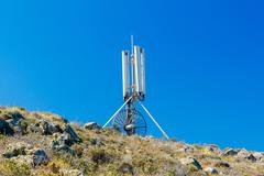 Antenna mobile communication on the top mountain - stock photo