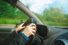 Female hands gripping car steering wheel Stock Photos