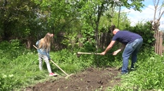 4K Father and Child Digging, Gardening, Cultivating Vegetables, Countryside View Stock Footage