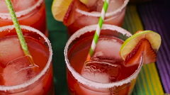 Strawberry and lime margaritas on the party table. Stock Footage