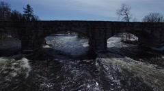 4k aerial sideways along stone bridge Stock Footage