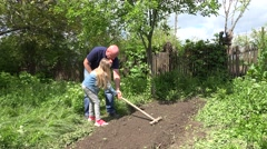 4K Father and Child Digging, Gardening, Cultivating Vegetables, Countryside View - stock footage
