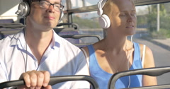 Commuters enjoying music in the bus Stock Footage