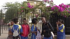 Praia, Cape Verde Islands, school girls smile outside Liceu Stock Footage
