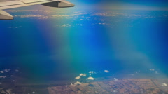 View Sea Land under Airliner Wing Stock Footage