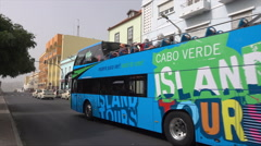 Praia, Cape Verde Islands, Island tourism tour bus passes along main street Stock Footage