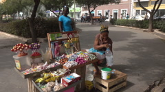 Praia, Cape Verde Islands, woman street seller serves customer Stock Footage