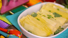 Home made tamales on serving plate on the party table. Stock Footage